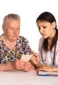 Doctor with granny — Stock Photo