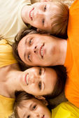 Happy family on carpet — Stock Photo
