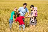 Family at field — Stock Photo