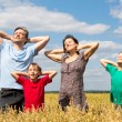 Family of a four at field — Stock Photo #6580006