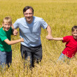 Dad with sons at field — Stock Photo #6580034