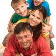 Stock Photo: Family on a carpet