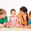 Family on a carpet - Stock Photo