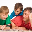 Dad and sons reading - Stock Photo