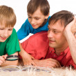 Stock Photo: Dad and sons reading