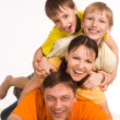 Happy family on carpet - Stock Photo