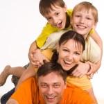 Happy family on carpet — Stock Photo #6681878