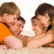 Royalty-Free Stock Photo: Happy family on carpet