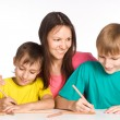 Mom draws with sons - Stock Photo