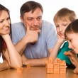 Happy family playing at table — Stock Photo #6681982
