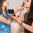 Two girls making up — Stock Photo