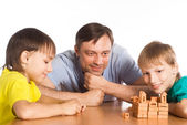 Dad plays with sons — Stock Photo