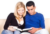 Cute couple reading — Stock Photo