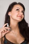 Girl with perfume — Stock Photo