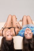 Two girls at sofa — Stock Photo