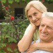 Happy old couple at nature — Stock Photo #6740684