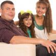 Family on sofa - Stock Photo