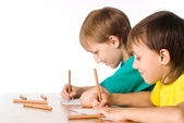 Two brothers drawing — Stock Photo