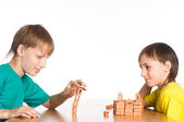 Two brothers playing at the table — Stock Photo