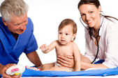 Baby and doctors — Stock Photo