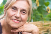 Nice old woman at nature — Stock Photo