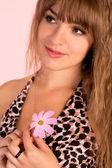Nice girl on a pink — Stock Photo