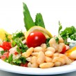 Delicious fresh salad with beans and tomatoes - Stock Photo