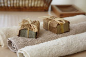 Soaps with towels and natural basket — Stock Photo