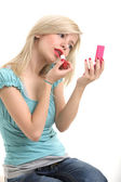Blonde doing make up — Stock Photo