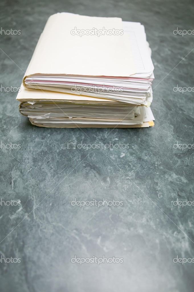 Files stacked on conference table, concept photography — Stock Photo #5718802