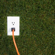 Foto de Stock  : Electrical outlet in grass