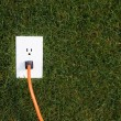 Electrical outlet in grass — стоковое фото #5778586