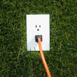 Electrical outlet in grass — Foto de Stock