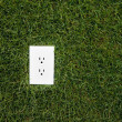 Electrical outlet in grass — Stock Photo #5778631