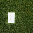 Stock Photo: Electrical outlet in grass
