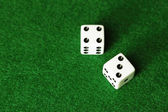 Dice on green background — Stock Photo