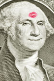 Lipstick kiss on one dollar bill — Stock Photo