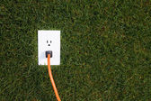 Electrical outlet in grass — Stock Photo