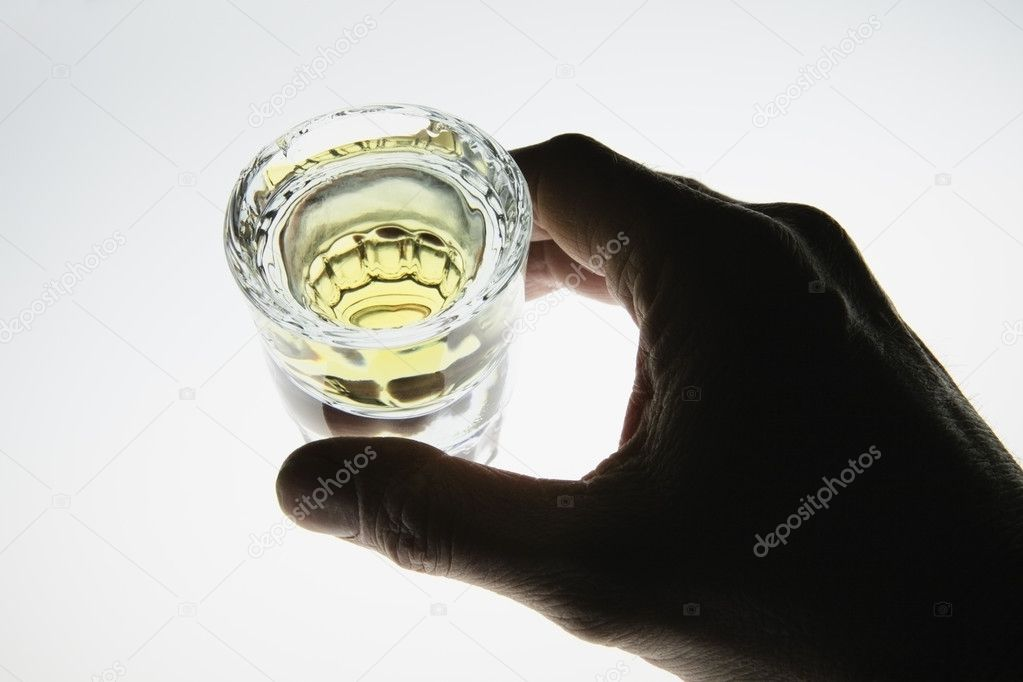Hand around shot glass of liquor, tequila — Stock Photo #5778160
