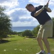 Stock Photo: Golfer Teeing Off on Maui