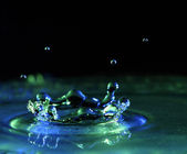 Splash in water with drops — Stock Photo
