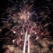 Sky full of white and blue fireworks — Stock Photo #5766054