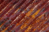 Rust pattern at angle on corrugated metal sheet — Stock Photo