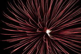 Single large red starburst fireworks — Stock Photo
