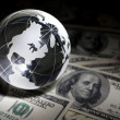 Globe and dollar — Stock Photo
