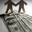 Dollar and Paper Chain Men — Stock Photo