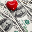 Stock Photo: Red Heart and Hundred Dollar Bills