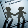 Employment Contract and Paper Chain Men - Stock Photo