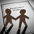 Insurance Policy and Paper Chain Men — Stock Photo
