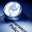 Globe and Insurance Policy — Stock Photo #5920955